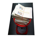 Pile of lottery on weight scale royalty free stock images