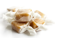 Pile of luxury wrapped caramel toffees  in perspective. Stock Photography