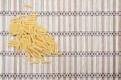Pile of macaronion striped background. Pile of macaroni on striped pattern background Royalty Free Stock Image