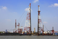Pile machine floating on the river. For bridge building Stock Images