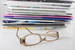 Pile of magazine and eyeglasses Royalty Free Stock Photo
