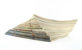 Pile of magazines. Pile of old weathered magazines on white background Royalty Free Stock Photos