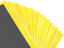 Pile of magazines. A pile of magazines with yellow covers, isolated stock photos