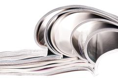 Pile of magazines with bending pages Stock Photo