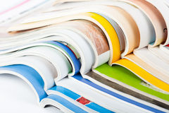 Pile of magazines. Pile of colorful paper magazines royalty free stock photo