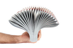 Pile of magazines in hand isolated over white Royalty Free Stock Photo