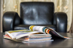 Pile of magazines at home Royalty Free Stock Images