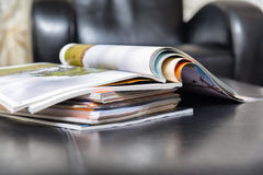 Pile of magazines at home Stock Photos