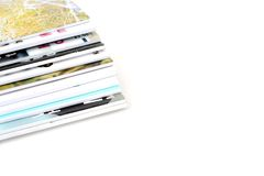 A pile of magazines. On isolated white background Stock Photo