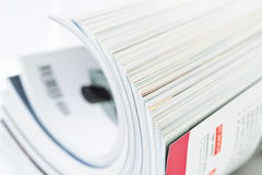 Pile of magazines, shallow DOF Stock Images