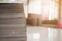 Pile of magazines stack on white table in living room Stock Image