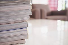 Pile of magazines stack on white table in living room. Close up Stock Photography