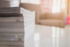 Pile of magazines stack on white table in living room. Close up Royalty Free Stock Photos