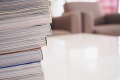 Pile of magazines stack on white table. In living room, close up Royalty Free Stock Photos