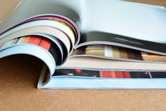 Pile of magazines on table. Stock Photo