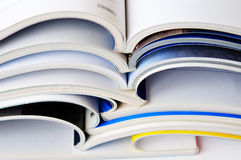 Pile of magazines. On white Stock Image