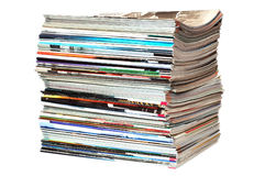 Pile of magazines on white. Pile of old magazines on white Royalty Free Stock Photos