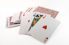 A pile of magicians trick cards. Showing more than one ace of hearts Royalty Free Stock Photo