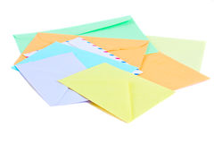 Pile of mail. Pile of colorful envelopes on white background stock image