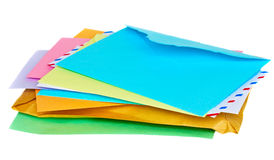 Pile of mail. Pile of colorful envelopes isolated on white background royalty free stock image