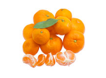 Pile of mandarin oranges and several segments of peeled mandarin Royalty Free Stock Photo