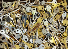 Pile of many different yellow and white old metal keys choice to open a door Royalty Free Stock Image