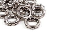 A pile of Many Hub - Wheel ball bearing ring. Close up A pile of Many Hub - Wheel ball bearing ring for bicycle at top left of picture isolated on white stock photo