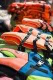 Pile of many life jackets Stock Photos