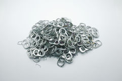 Pile of many Metal pull ring of can and used staple needle. Waste Stock Images