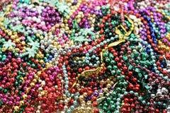 Pile of mardi gras beads Stock Photo