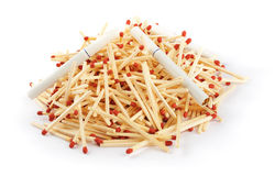 Pile of Matches with Cigarettes on Top Royalty Free Stock Images
