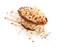 Pile of Matches in a Straw Basket Stock Photo