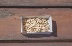 Pile of matchsticks in the box on a wooden bench. Stock Photos