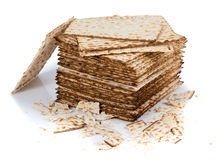 Pile of matza and some broken matza at the side Royalty Free Stock Photos
