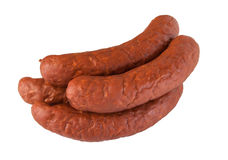 Pile meat flavour sausages on white Stock Images