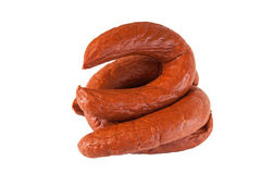 Pile meat flavour sausages on white Royalty Free Stock Image