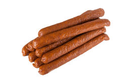 Pile meat flavour sausages on white Royalty Free Stock Images