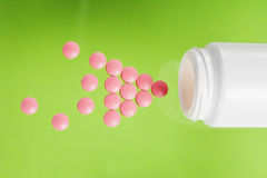 Pile of medical pills and bank on glass background Stock Photos