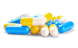 Pile of medical pills and blue pills Stock Images