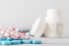 Pile of medical pills on wooden table royalty free stock photography