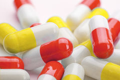 A pile of medical pills yellow and red Stock Image