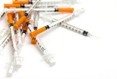 Pile of medical syringe isolated on white. Background Royalty Free Stock Image