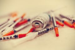 Pile of medical syringes for insulin stock image