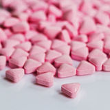 Pile of medicinal pink pills Royalty Free Stock Images