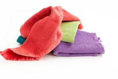 Pile of messy and folded colorful kitchen towels. Pile of  messy and folded colorful kitchen towels, on white background Stock Photos