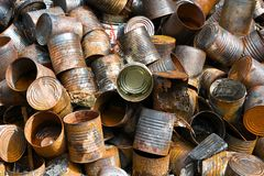 Pile of Metal Cans. A pile of metal cans and other items at an Illegal Dump Site stock photo