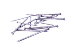 Pile of metal nails. Isolated over white background Stock Images