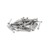 Pile of metal nails isolated over white background, view above.  stock photo