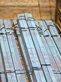 Pile of metal profiles square in a freight carriage. Royalty Free Stock Photo