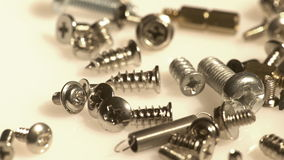 Pile of metal screws closeup stock footage